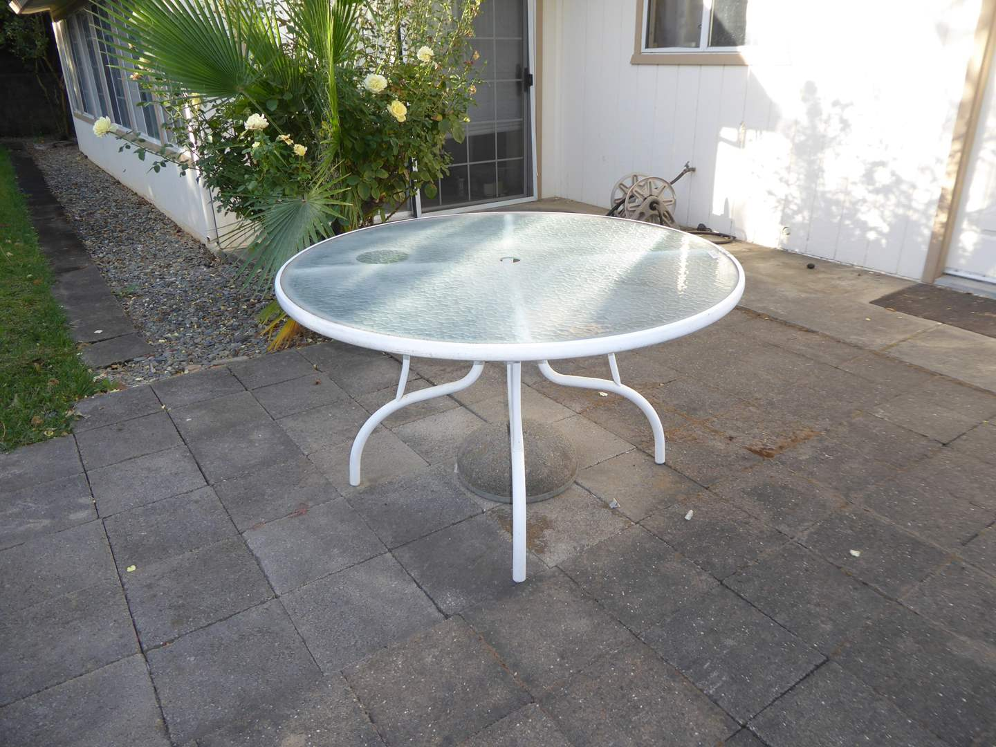 Lot # 167 - Outdoor Table W/Glass Top & Cement Umbrella Stand  (main image)
