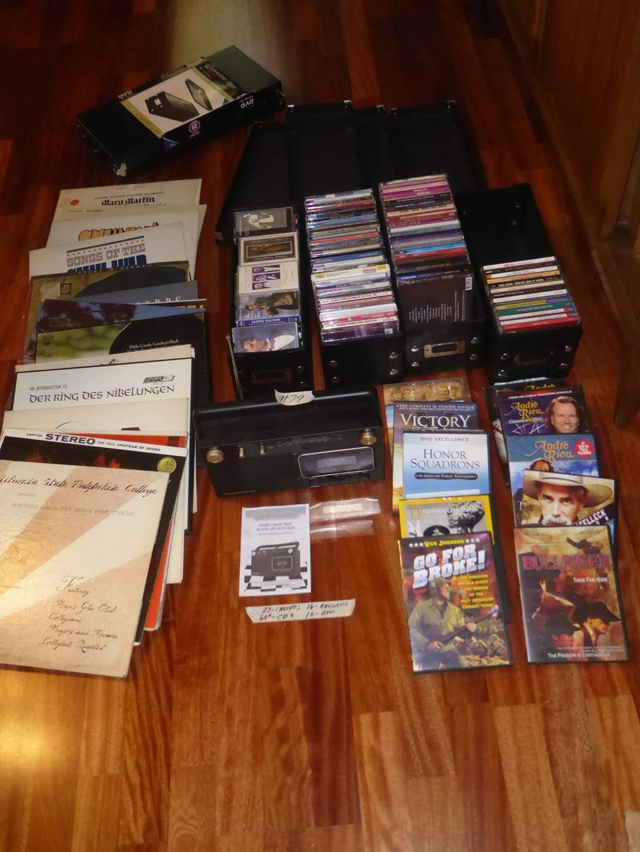 Lot # 79 - Studebaker Portable Cassette Player AM/FM Radio, 27 Cassettes, 16 Records, 60+ CD's & 10 DVD Movies (main image)