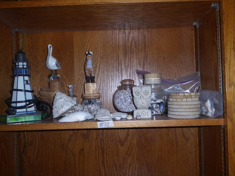 Lot # 72 - Lighthouse Lamp, Pelican, Captain & Owl Figurines & Seashells (main image)