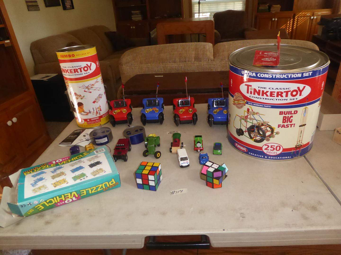 Lot # 114 - Tinkertoys, Battery Operated Cars, Wireless Mini R/C Racers, Wind Up Puzzle Vehicles & Rubik Cubes (main image)