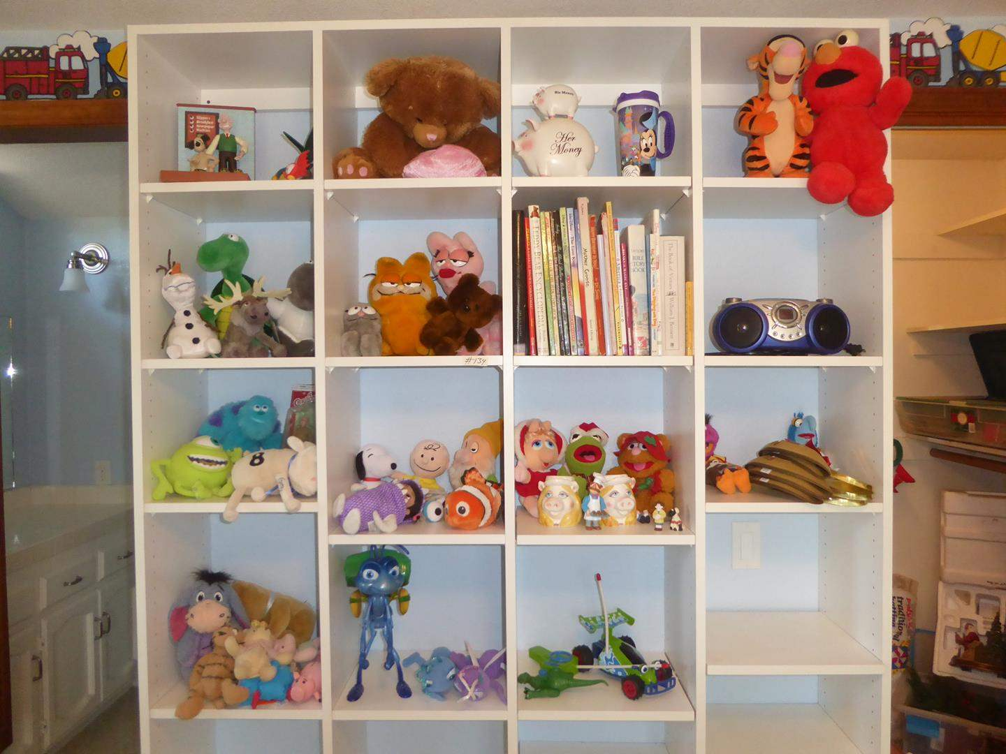 Lot # 134 - Children's Stuffed Animals, Toys, Books & Portable Compact Disk Player - Shelving Not Included (main image)