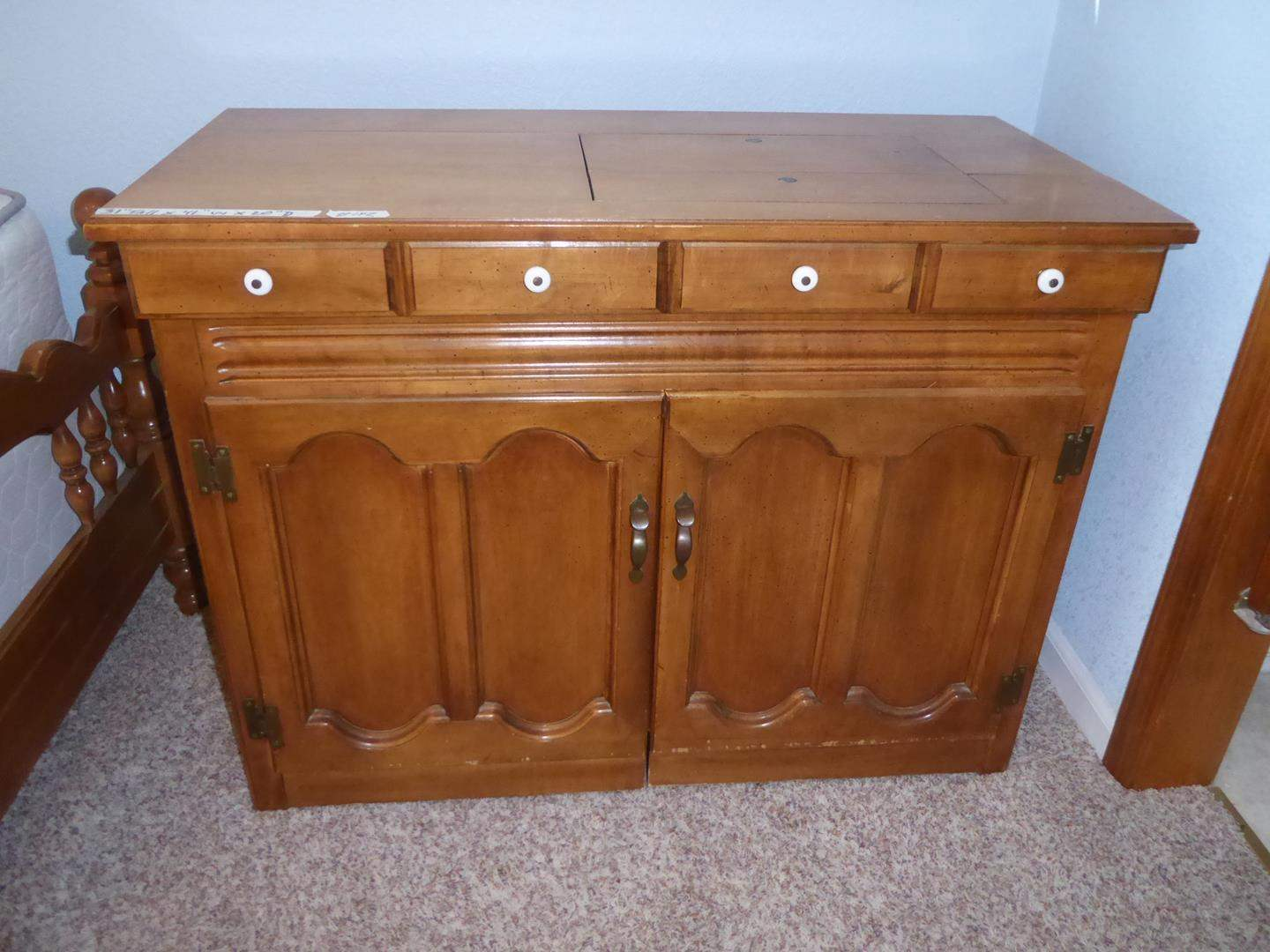 Lot # 142 - Vintage Sewing Machine Cabinet & Notions (main image)