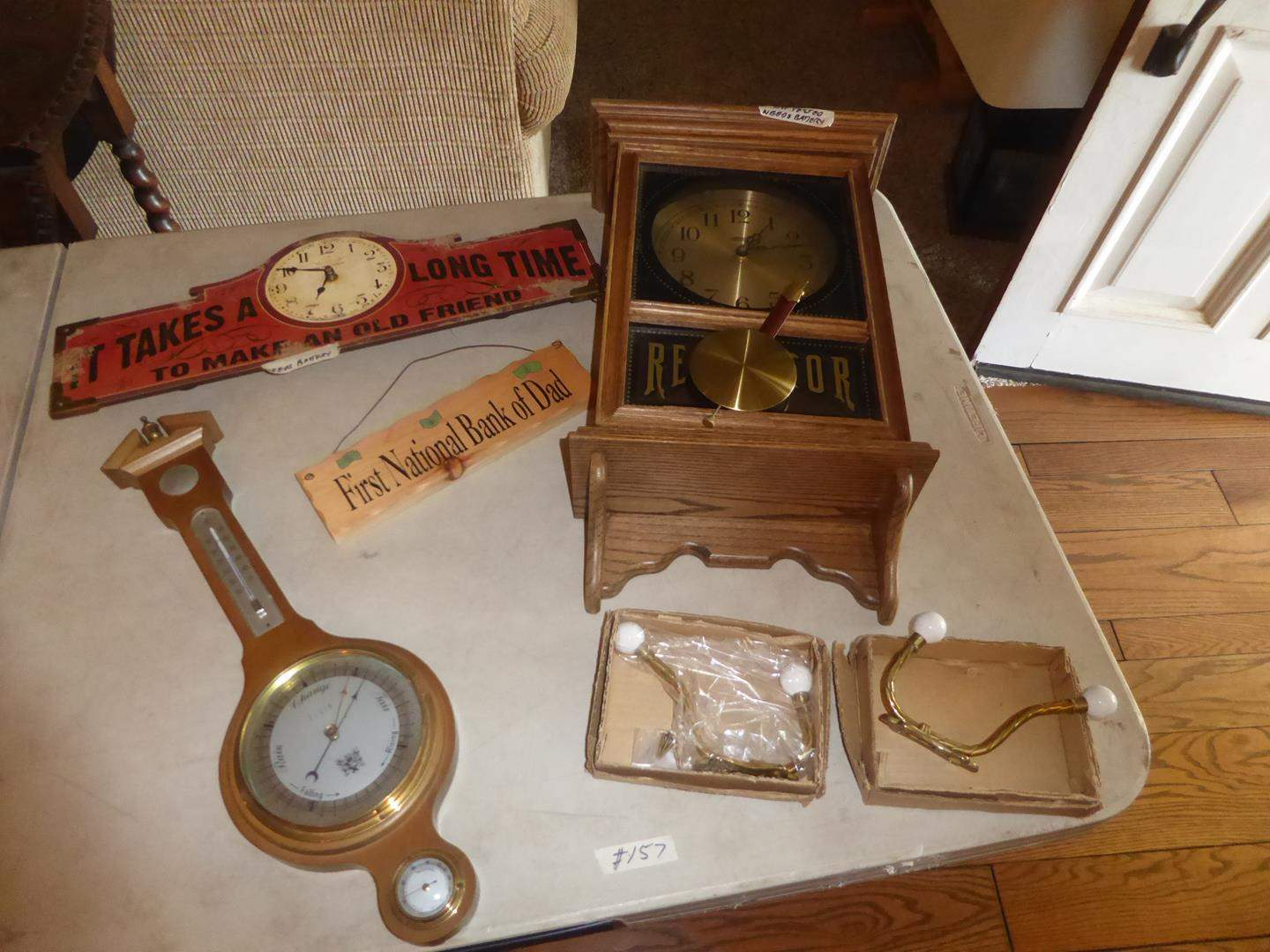 Lot # 157 - Coat Hooks, Barometer, Sign & Clocks (main image)