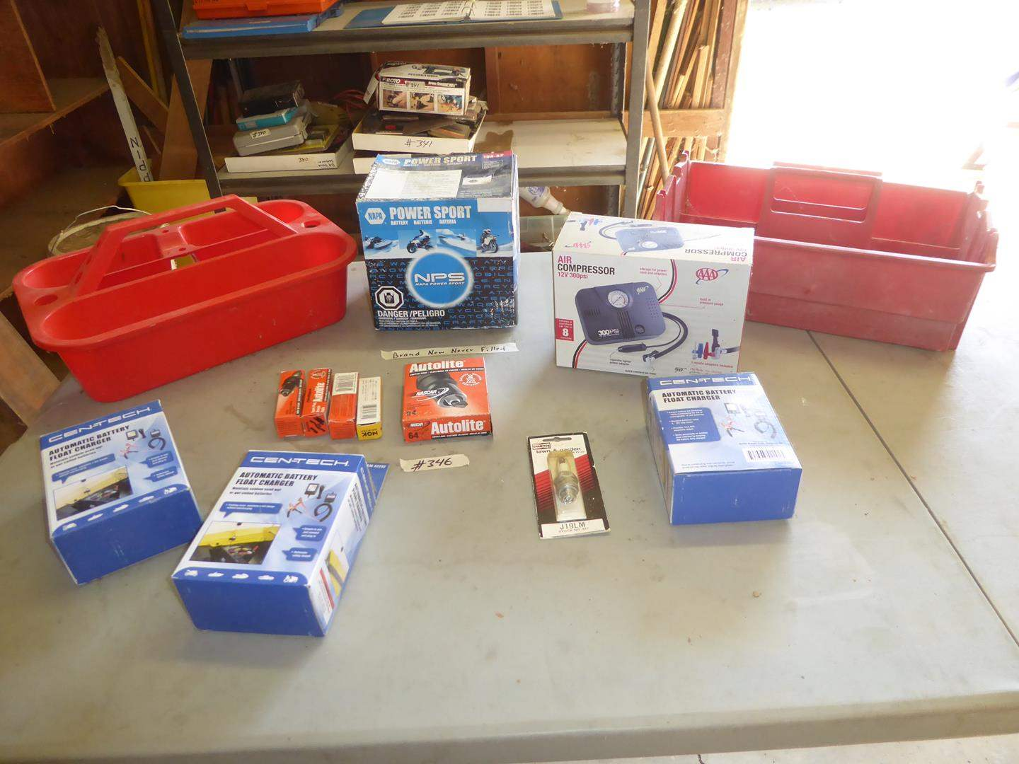 Lot # 346 - Napa Power Sport Battery (new), Three Battery Float Chargers, Air Compressor & Spark Plugs (main image)