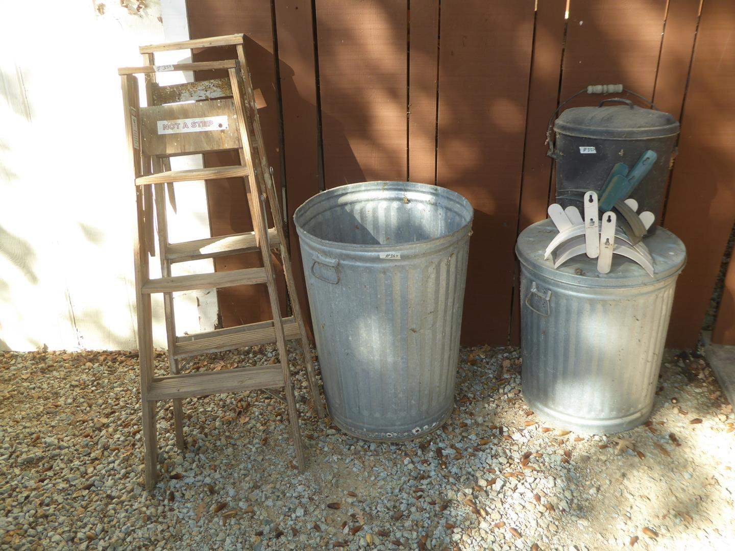 Lot # 354 - Two 4' Wooden Ladders, Aluminum Trash Cans & Hose Reels (main image)