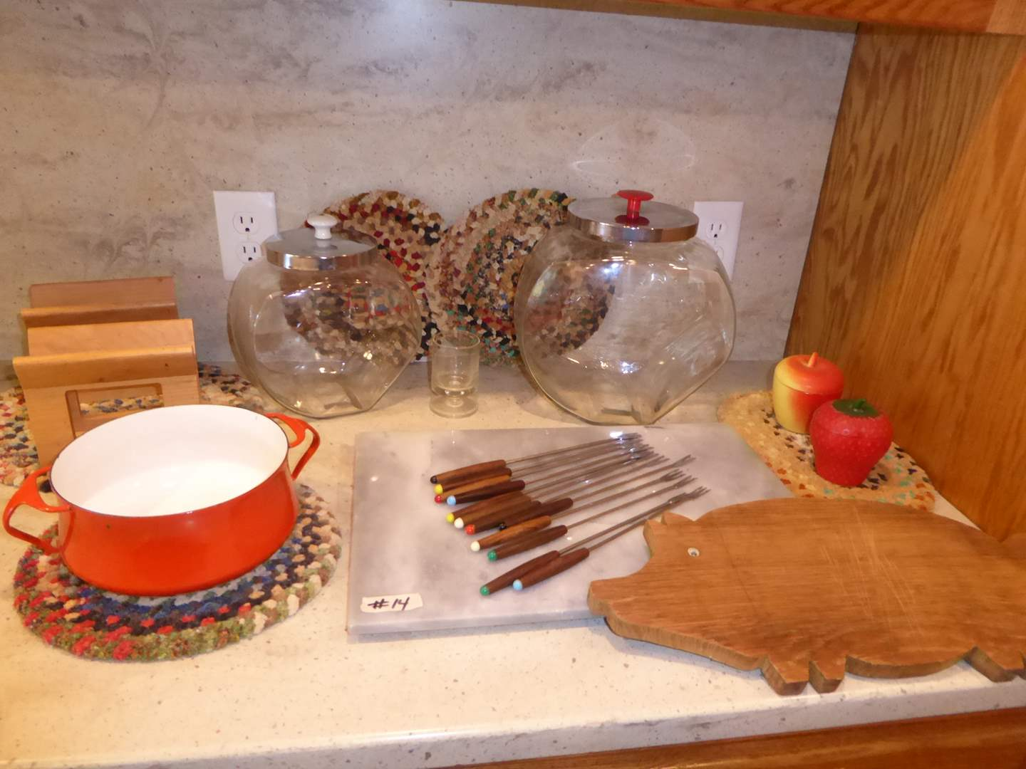 Lot # 14 - Vintage Handmade Hot Pads, Wooden Pig Cutting Board & More  (main image)