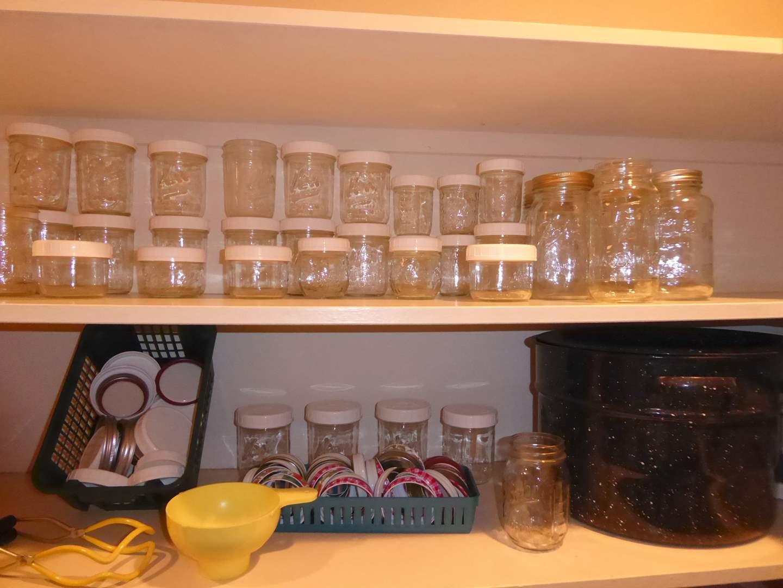 Lot # 19 - Glass Jars, Lids & Graniteware Pot  (main image)