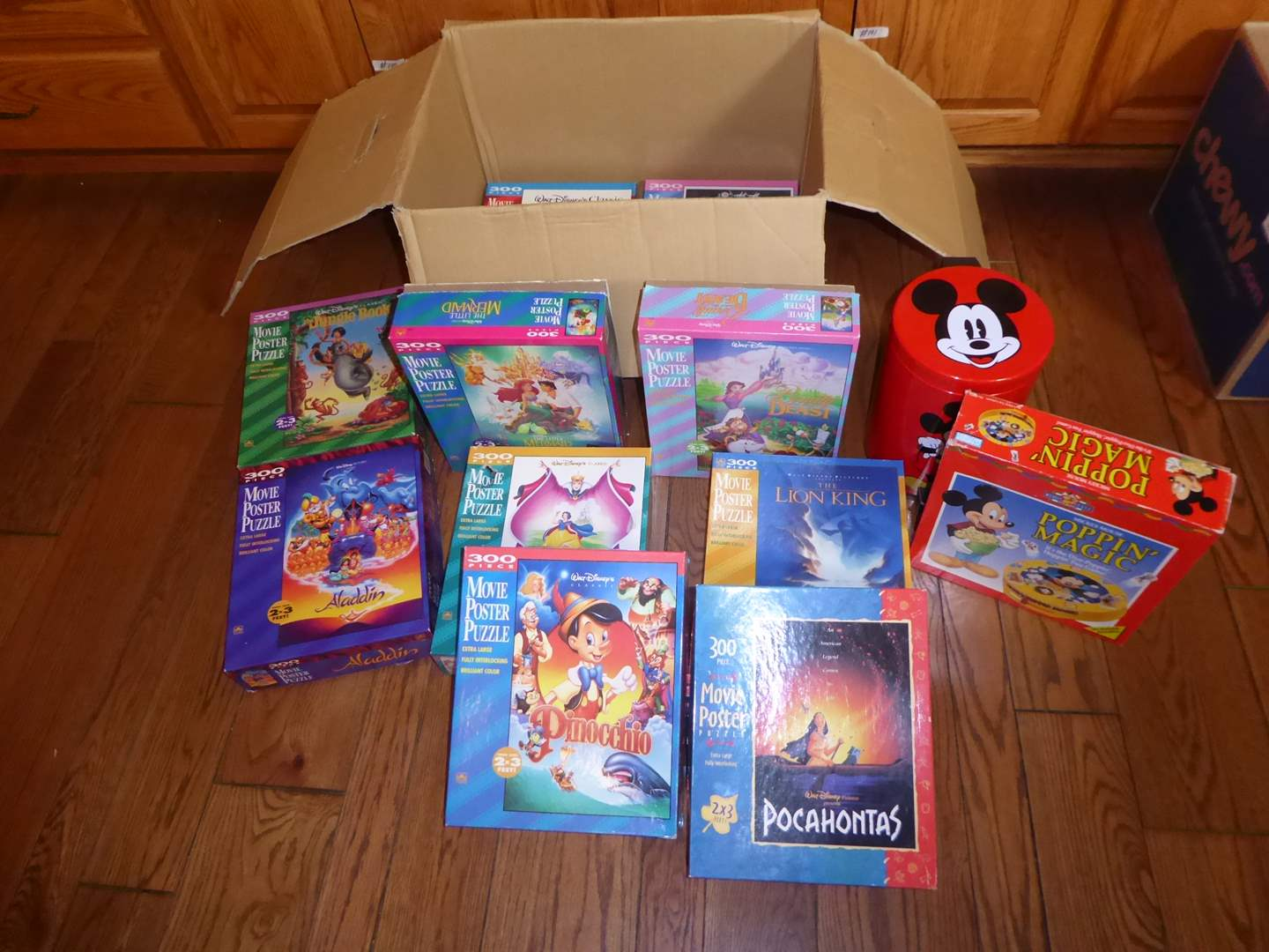 Lot # 49 - Disney Movie Poster Puzzles, Mickey Mouse Game & Trashcan  (main image)