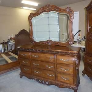 Lot # 52 - 'Pulaski' Wooden Furniture Ornate 9 Drawer Dresser w/Beveled Mirror