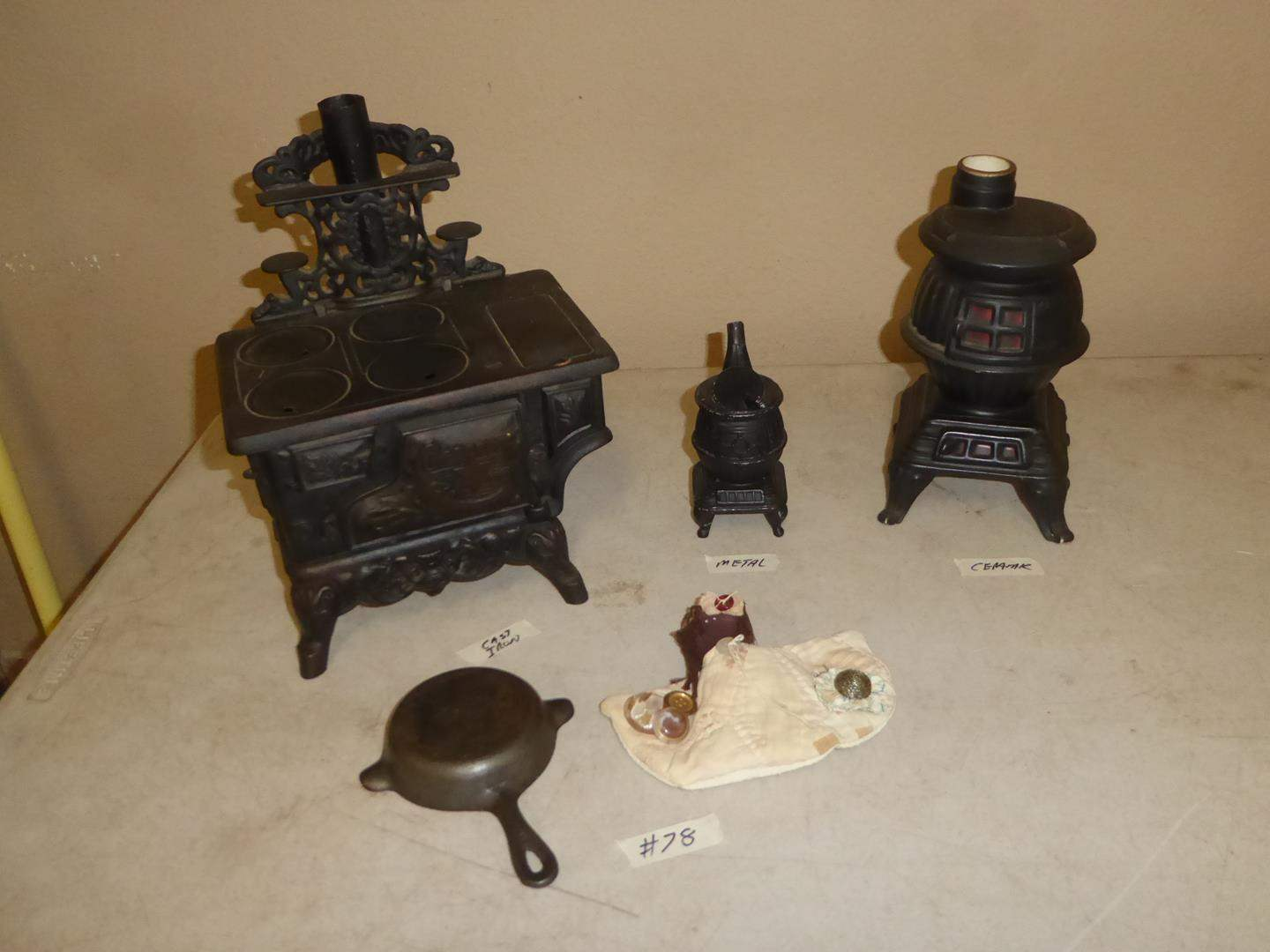 Lot # 78 - Vintage Wagner Cast Iron Skillet Ashtray, Crescent Salesman Sample Stove, Metal Pot Belly Stove & Stove Decanter (main image)