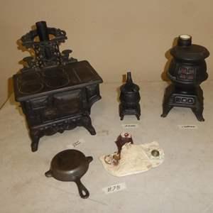 Lot # 78 - Vintage Wagner Cast Iron Skillet Ashtray, Crescent Salesman Sample Stove, Metal Pot Belly Stove & Stove Decanter