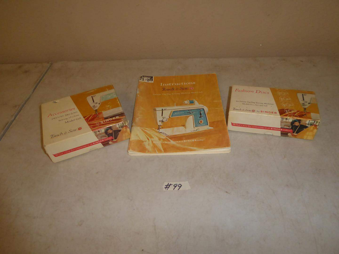 Lot # 99 - Vintage Singer Sewing Machine Accessories & Manual (main image)