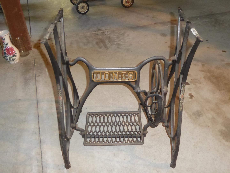 Lot # 234 - Antique Jones Treadle Sewing Machine Base on Casters (main image)