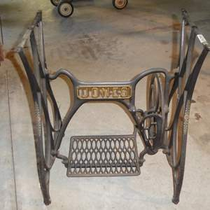 Lot # 234 - Antique Jones Treadle Sewing Machine Base on Casters