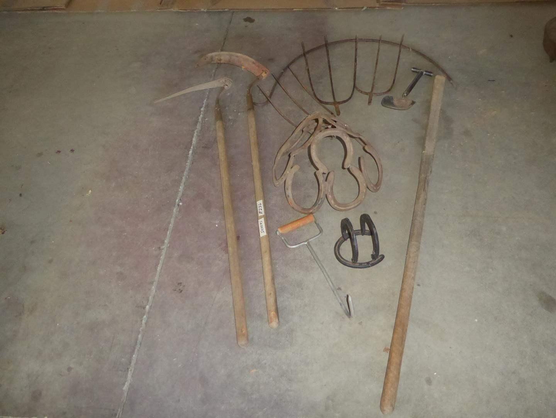 Lot # 236 - Vintage Scythe Sickles, Horseshoe Art & Hay Forks (main image)