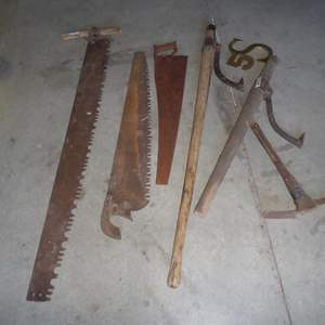 Lot # 252 - Old Saws & Log Rollers