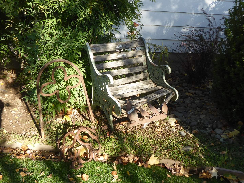 Lot # 5 - Cute Small Cast Iron Bench With Wooden Slats & Handmade Horseshoe Yard Art  (main image)