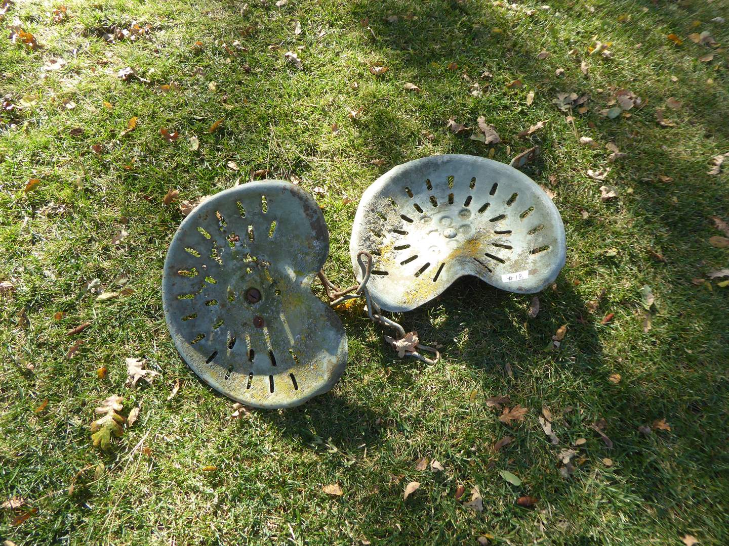 Lot # 18 - Two Vintage Tractor Seats  (main image)