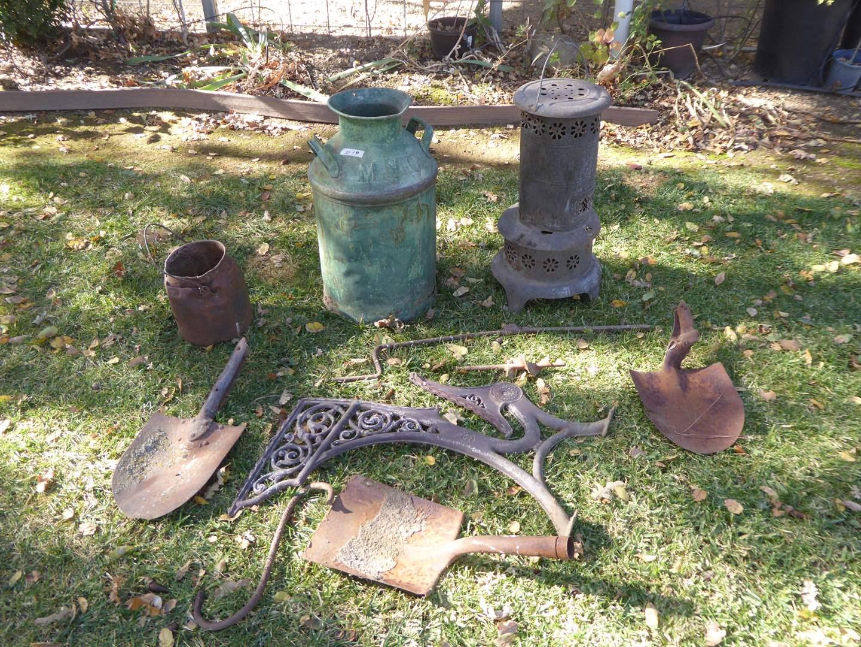 Lot # 19 - Yard Art - Milk Jug, Heater, Old Farm Tools & More   (main image)