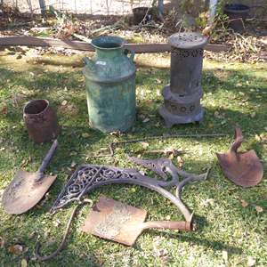 Lot # 19 - Yard Art - Milk Jug, Heater, Old Farm Tools & More