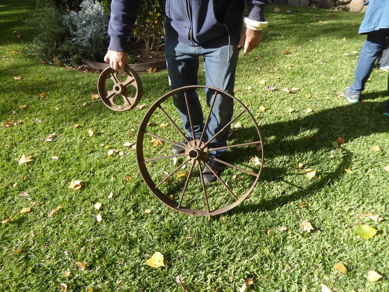 Lot # 37 - Two Vintage Metal Wheels  (main image)