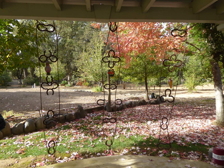 Lot # 40 - Three Handmade Horseshoe Garden Features  (main image)