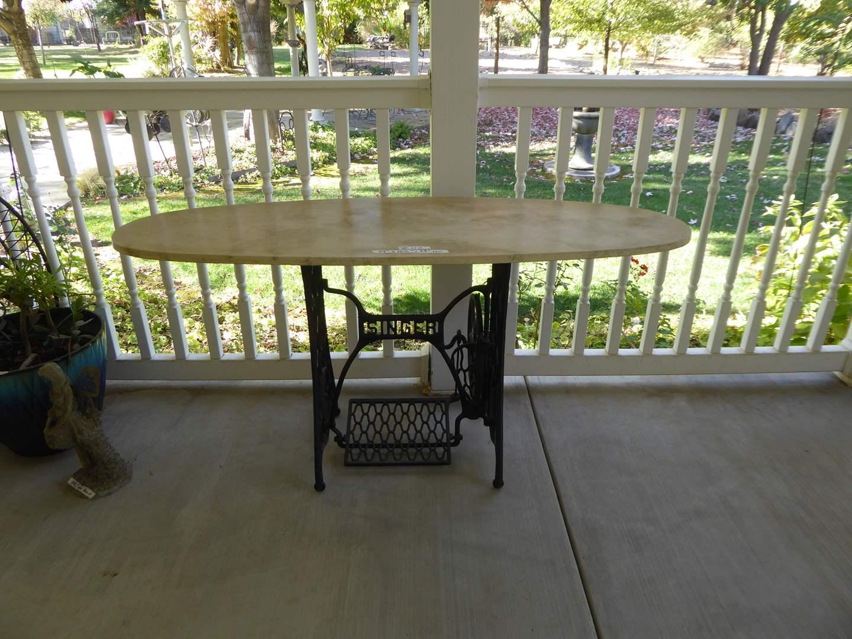 Lot # 112 - Heavy Plaster Table W/ Singer Base   (main image)