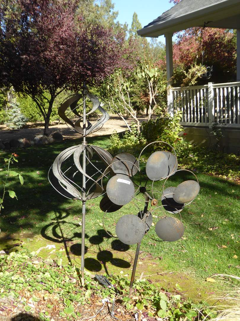 Lot # 120 - Two Handmade Metal Wind Spinners  (main image)