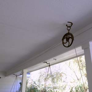 Lot # 109 - Vintage Pulley (made into a clothes line)