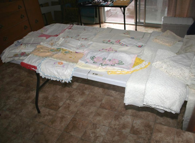 Lot #70 - Table Full of Vintage Needlepoint - Table Linens & More (main image)