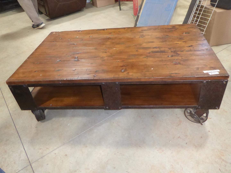Lot # 51 - Industrial Rustic Solid Wood Coffee Table on Wheels