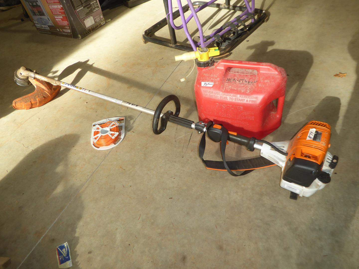 Lot # 74 - Stihl Weed Trimmer w/String & Gas (main image)