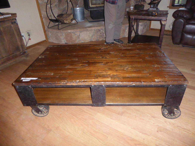 Lot # 202 - Rustic Industrial Solid Wood Coffee Table on Metal Wheels (main image)