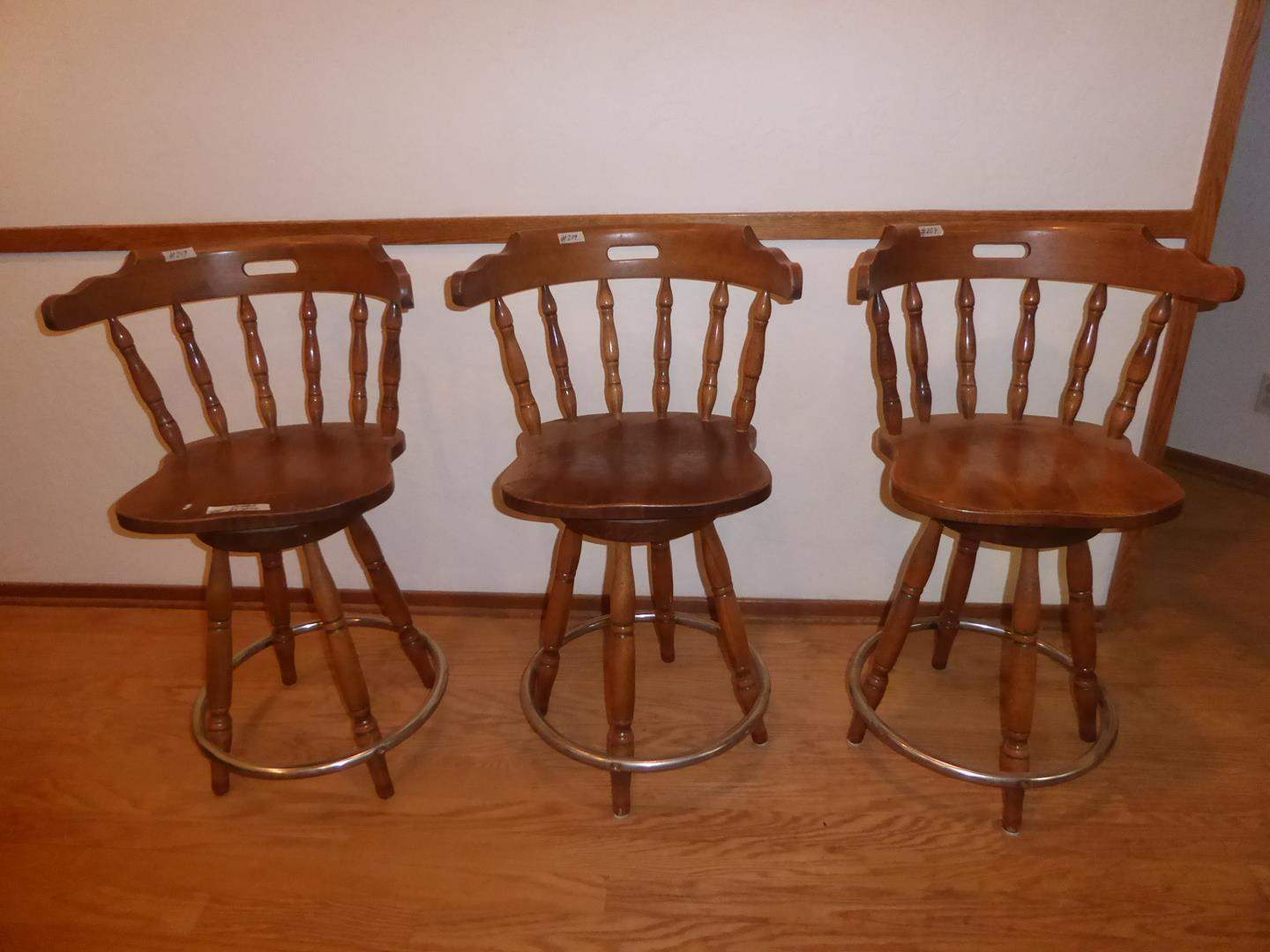 Lot # 209 - Three Solid Wood Swivel Bar Stools (main image)