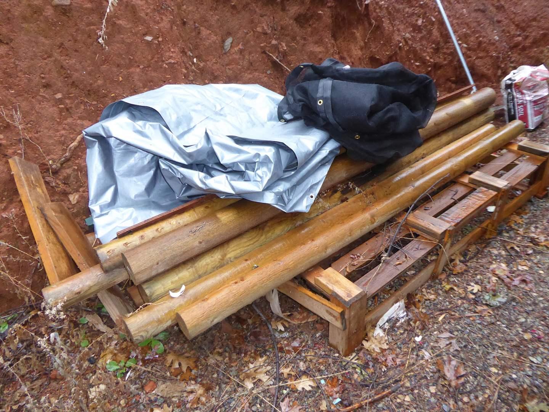 Lot # 17 - 12 Peeler Logs, Large Tarp & Large Mesh Tarp  (main image)