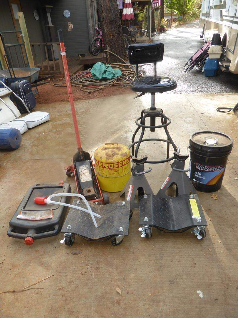 Lot # 64 - Waste Oil Storage Container, Floor Jack, Car Wheel Dollies, Swivel Shop Stool & More
