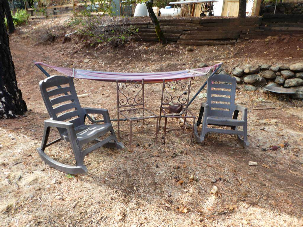 Lot # 317 - 2 Heavy Iron Chairs, 2 Rocking Chairs & Hammock Frame