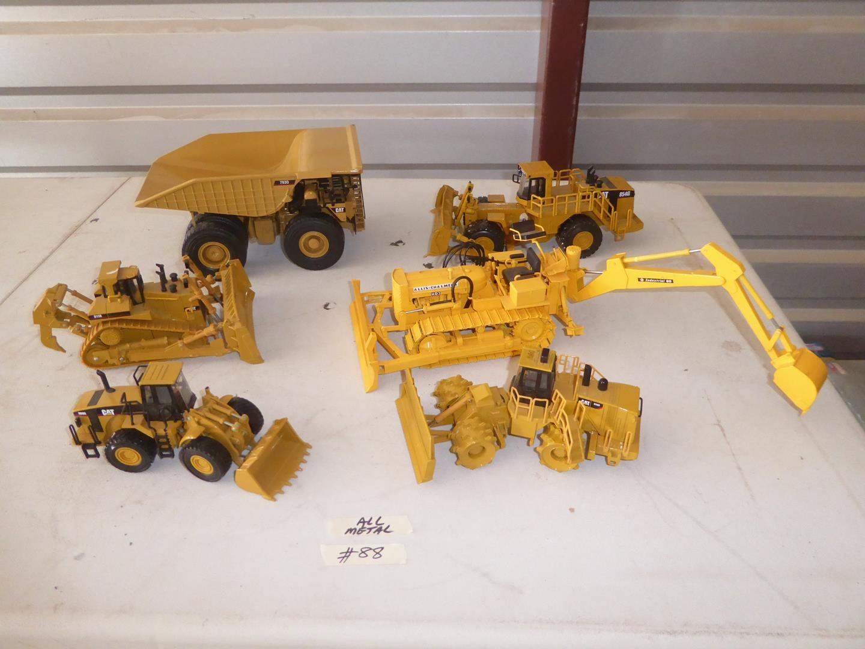 Lot # 88 - Metal Caterpillar Construction Earth Movers Toys  (main image)