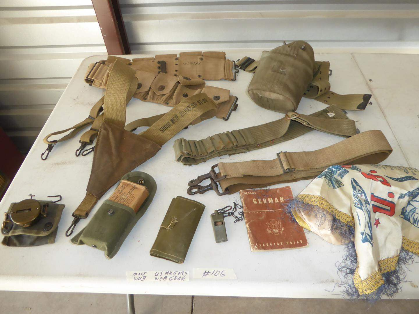 Lot # 106 - Vintage WWII US Military Web Gear & More (main image)