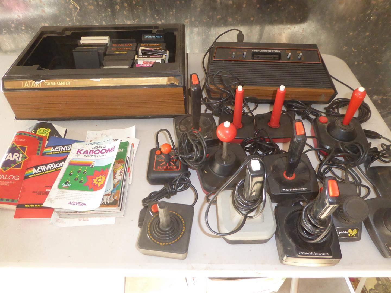 Lot # 135 - Vintage Atari System, Games & Controllers (main image)