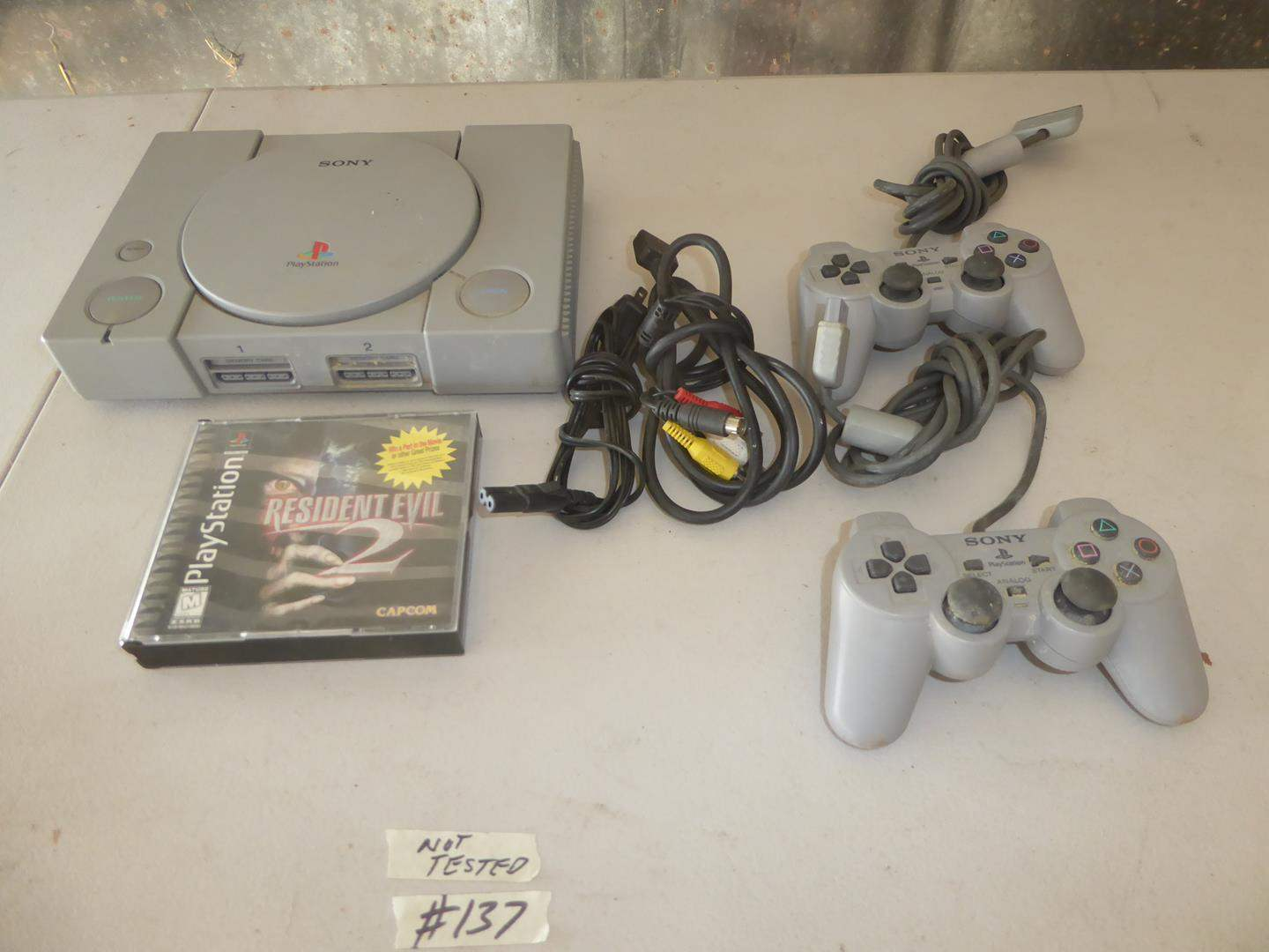 Lot # 137 - Vintage Sony PlayStation, Controllers & Game (main image)