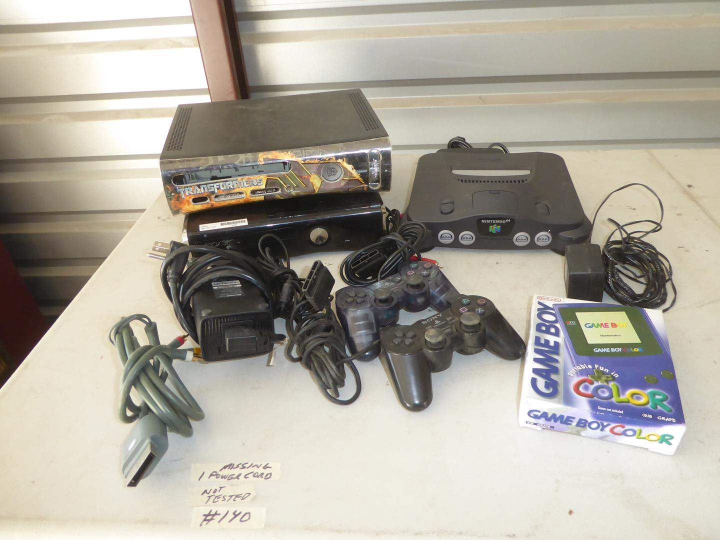 Lot # 140 - Two XBOX 360's, Nintendo 64, Controllers & Game Boy (main image)