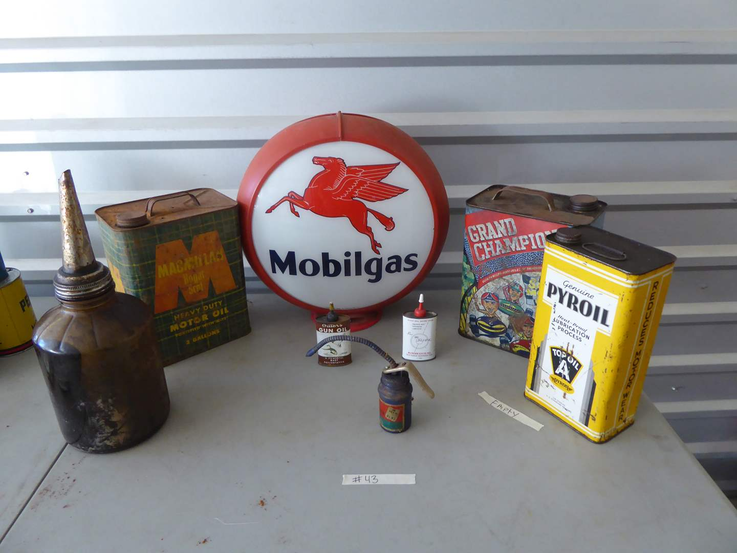 Lot # 43 - Mobilgas Display Sign (No Light) & Vintage Oil Cans   (main image)