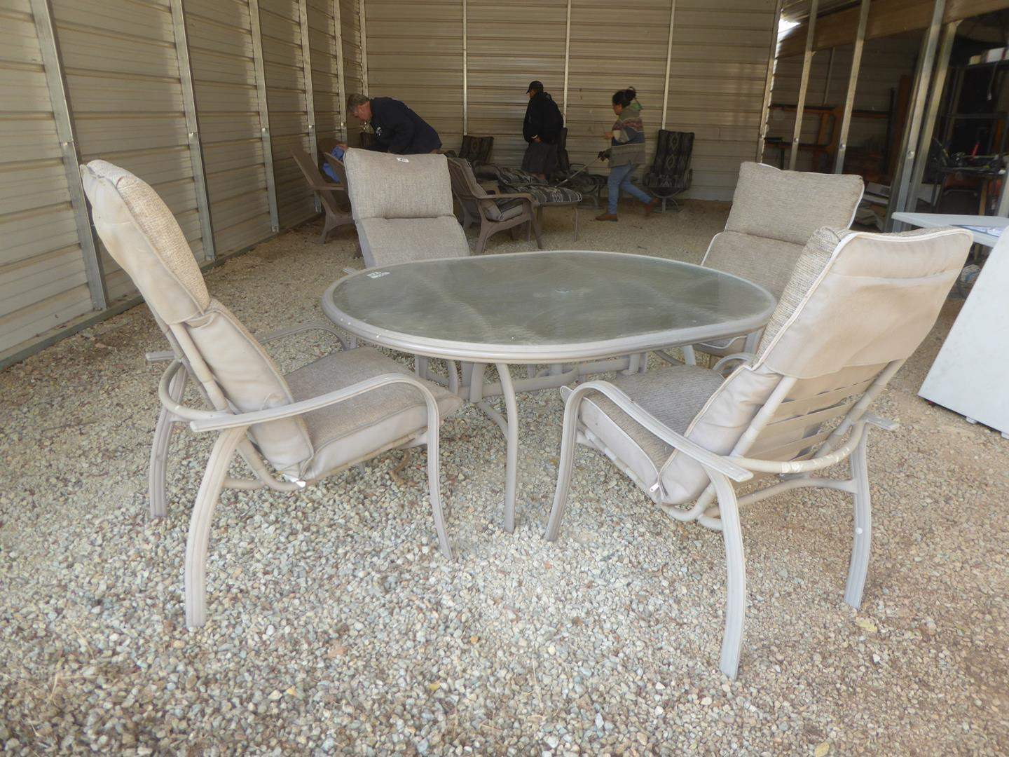 Lot # 50 - Quality Glass Top Patio Table & Four Aluminum Framed Chairs w/Light Beige Cushions (main image)