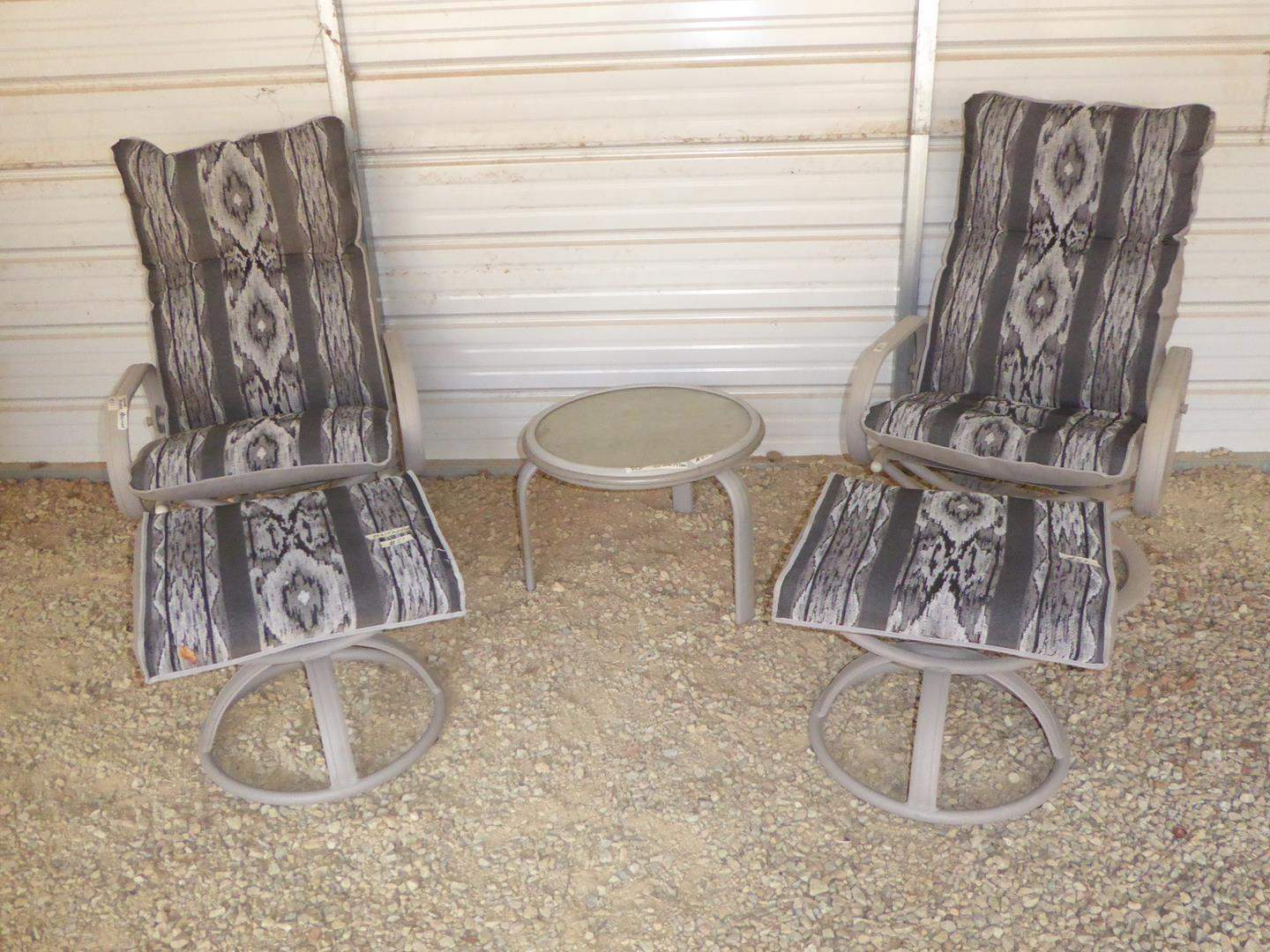 Lot # 51 - Quality Pair Swivel Rocker Recliner Patio Chairs w/Cushions, Matching Ottomans & Small Glass Top Drink Table (main image)