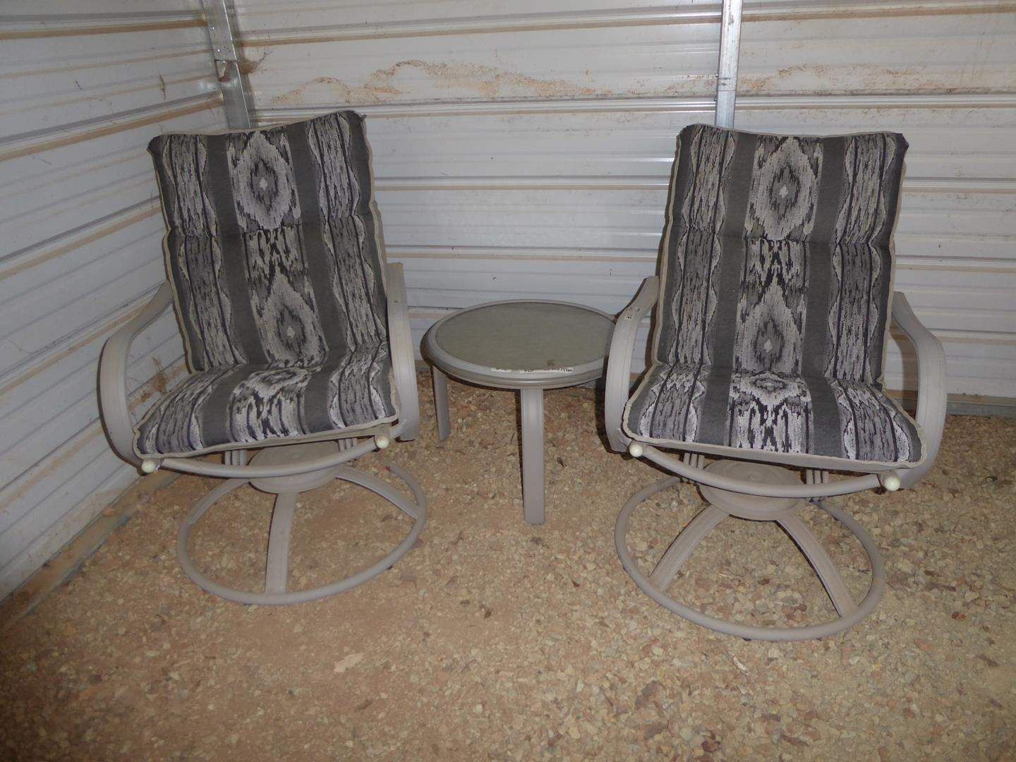 Lot # 52 - Quality Pair Swivel Rocker Patio Chairs w/Cushions & Small Glass Top Drink Table (main image)
