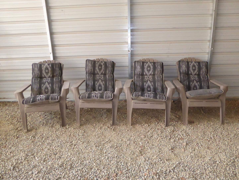 Lot # 54 - Four Sturdy Plastic Patio Chairs w/Cushions (main image)