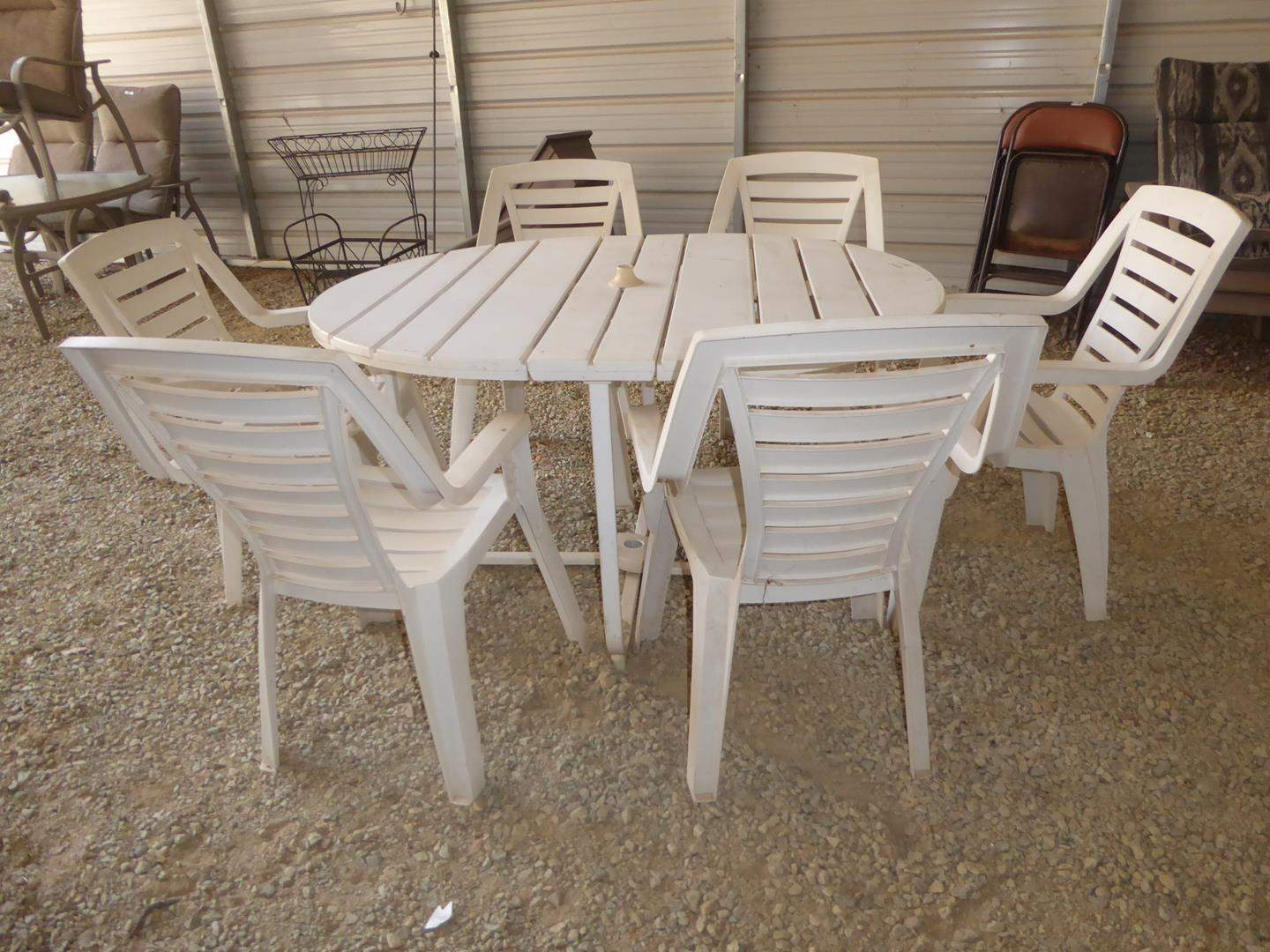 Lot # 57 - Sturdy White Plastic Patio Table & Six Matching Chairs (main image)