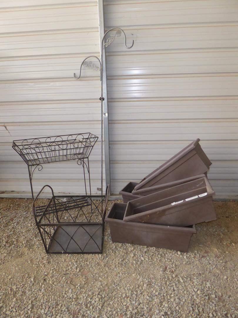 Lot # 60 - Metal Planter Stand, Metal Kindling or Firewood Basket, Five Plastic Planters & Plant Hanger (main image)