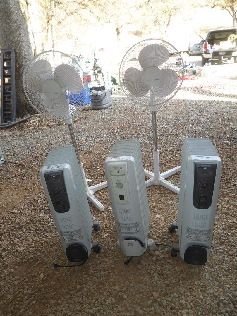 Lot # 72 - Three Electric Oil Filled Radiator Space Heaters & Two Floor Fans (main image)